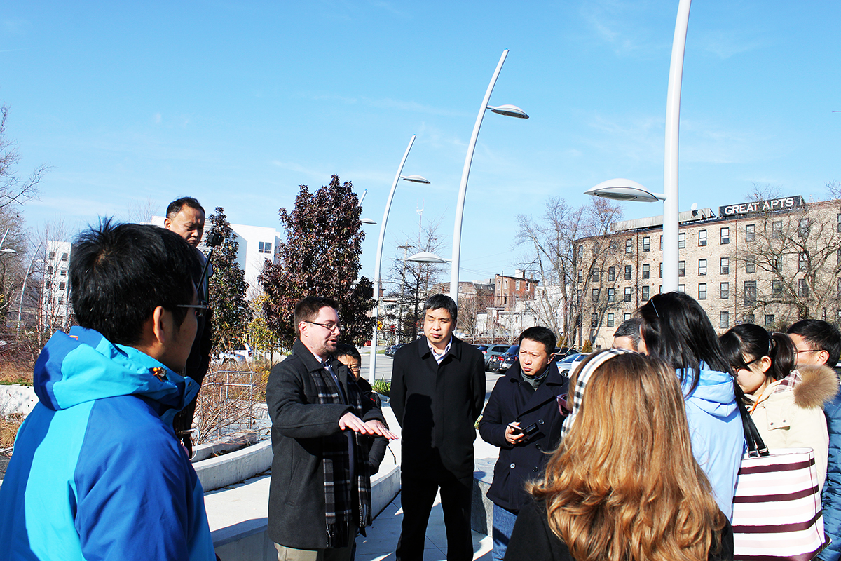 Visitors from China inspect Philadelphia green stormwater infrastructure sites during a Dec. 14 tour hosted by the Philadelphia Water Dept.