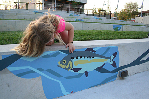 A girl checks out the Waterways art at the Venice Island Performing Arts and Recreation Center. Photo credit: Philadelphia Water.