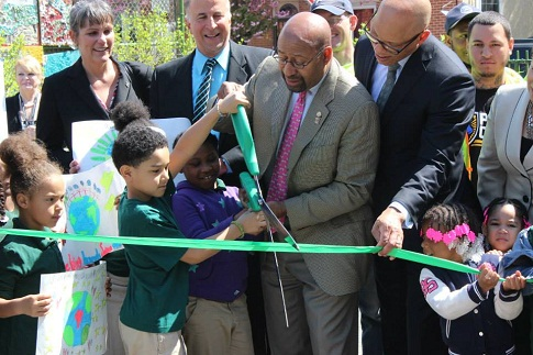 Mayor Nutter and Dr. Hite join George W. Nebinger students in a ribbon cutting for their green schoolyard on Earth Day 2015.