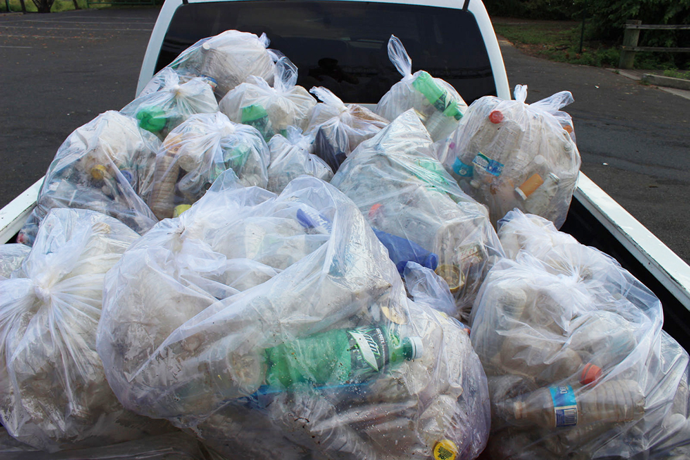 "Dozens of bags of ""floatable"" trash pulled from the Delaware River during a 2015 volunteer cleanup. MLK Day of Service volunteers who participate in neighborhood trash removal will also be helping our rivers because cleaner streets = cleaner creeks and rivers. Credit: Philadelphia Water."