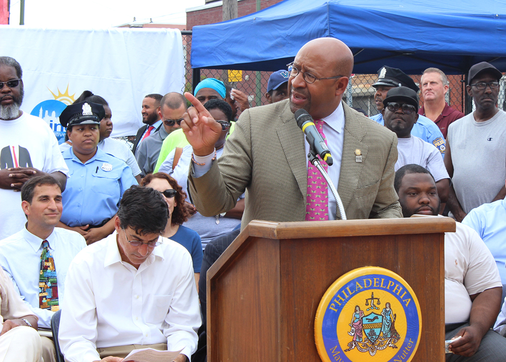 Mayor Michael Nutter speaks at the ribbon cutting for Ralph Brooks Park. Philadelphia Water will join Nutter for one last celebration of green infrastructure and community collaboration on Monday, December 28. Credit: Philadelphia Water.