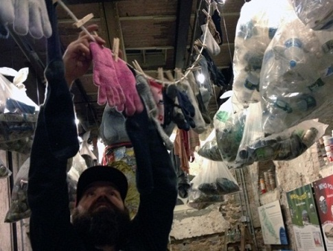 "Artist Bradley Maule works on ""One Man's Trash."" Fairmount Water Works Photo."