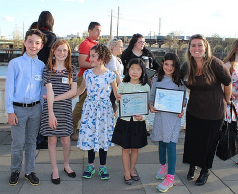 Winners from the K-2nd grade category celebrate along the Schuylkill with judge Tiffany Ledesma. Photo: Brian Rademaekers